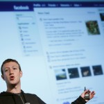 Facebook CEO Zuckerberg gestures while speaking to the audience during a media event at Facebook headquarters in Menlo Park